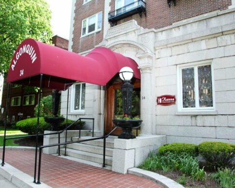Elegant red awning over the front entrance of the Algonquin building on Goodman Street in Rochester, NY
