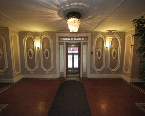 Interior lobby with crown molding and tile floor