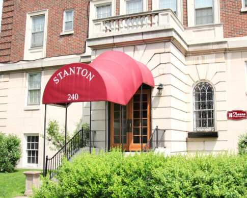 Elegant red awning over the front entrance of the Stanton building on Goodman Street in Rochester, NY