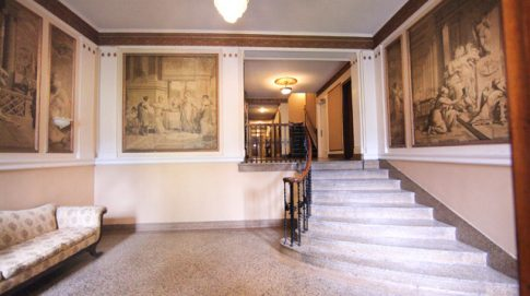 Interior lobby with orignal murals and marble staircase