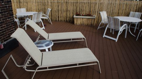 Patio furniture and bamboo fence along the Stanton Rooftop deck