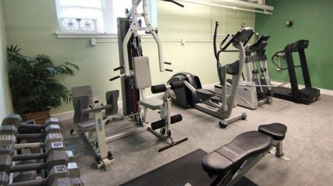 Fitness center furnished with free weights and excercise equipment